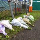 Floral tributes left on Eastern Avenue, Grays, Essex, where 39 bodies were discovered in a lorry (Kirsty O'Connor/PA)