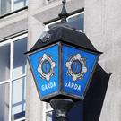 A stock picture of the Garda badge logo (Niall Carson/PA)