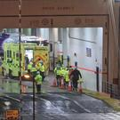 Detectives are questioning the driver and owners of a lorry after 16 people were discovered in a sealed trailer on board a ferry (Niall Carson/PA)