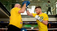 On the up: James Tennyson works out in Liverpool with coach Tony Dunlop