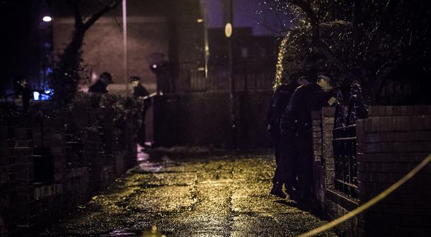 Police officers inspect blood on the ground after a man in his 50's was shot in the Dunville Street area of west Belfast on October 23rd 2019 (Photo by Kevin Scott for Belfast Telegraph)