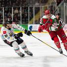 Belfast Giants defenceman Kevin Raine tracks Cardiff Devils forward Masi Marjamaki down the boards in their clash at the Viola Arena, Cardiff