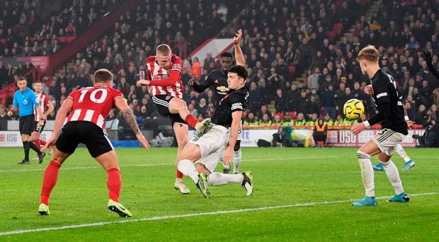 Ollie day: Oliver McBurnie blasts Sheffield United's last gasp equaliser to deny Manchester United victory at Bramall Lane