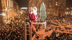 Santa arrives over a crowd of thousands from Derry's Walls as he to switched on the Christmas Lights in Guildhall Square. Picture Martin McKeown. Inpresspics.com. 22.11.18