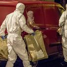 Forensics officers at a property in Market Street area of Keady following the sudden death of a baby on October 26th 2019 (Photo by Kevin Scott for Belfast Telegraph)