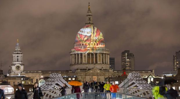 William Blake's final masterpiece 'The Ancient Of Days' is projected onto the dome of St Paul's Cathedral (Rick Findler/PA)