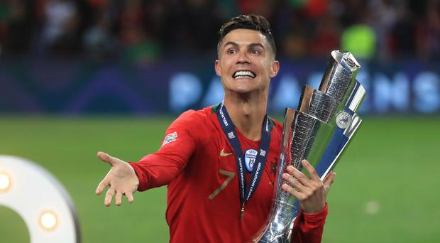 Cristiano Ronaldo's reigning European champions Portugal are possible group opponents for England or Wales (Mike Egerton/PA)