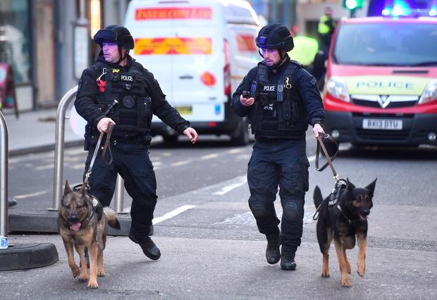 Police on Cannon Street in London near the scene of an incident on London Bridge in central London. Photo credit: Kirsty O'Connor/PA Wire