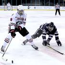 Northeastern's Tyler Madden gets away from the University of New Hampshire's Chase Stevenson (William Cherry/Presseye)