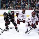 Northeastern Huskies forward Zach Solow tries to find his way through the Colgate Raiders defence in the Friendship Four final at the SSE Arena (William Cherry/PressEye)
