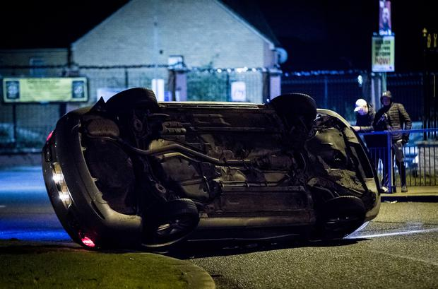 Police with a suspected stolen car that overturned at the Michael Ferguson roundabout on November 30th 2019 (Photo by Kevin Scott for Belfast Telegraph)