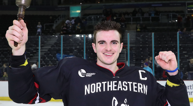 Thrilled: Huskies captain Ryan Shea with the Belpot Trophy