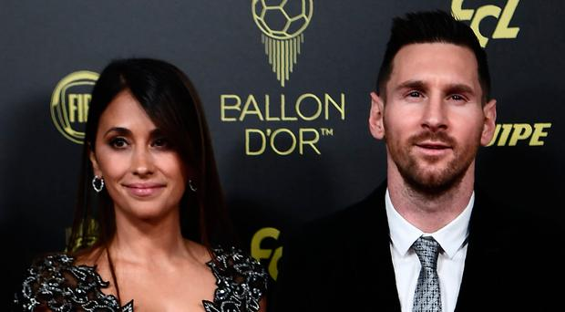 Family man: Ballon d'Or winner Lionel Messi with wife Antonella and sons Thiago and Mateo at the awards event in Paris last night