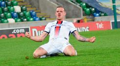Crucial strike: Coleraine's Aaron Canning celebrates opening the scoring at Windsor last night