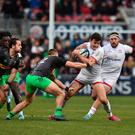 Ulster full-back Jacob Stockdale escapes the clutches of Harlequins centre James Lang at Kingspan Stadium (Charles McQuillan/Getty Images)