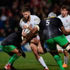 Man of the match Stuart McCloskey bursts the tackle of Harlequins lock Tevita Cavubati in Ulster's 25-24 win at Kingspan Stadium (Charles McQuillan/Getty Images)