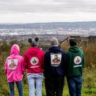 Paedohunters group Nonce Catchers NI lead by Kenny Abbott (right) and his team, look over Belfast from Upper Hightown Rd beside Cavehill.