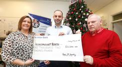 Generosity: James McGarrity (centre) presents a cheque for £1,200 to Glenda McAuley and Charles McGarry of Rosemount House.
