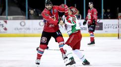 Belfast Giants' Matt Pelech and Cardiff Devils' Mark Louis drop the gloves during Wednesday night's Challenge Cup quarter-final first leg at the SSE Arena (William Cherry/Presseye)