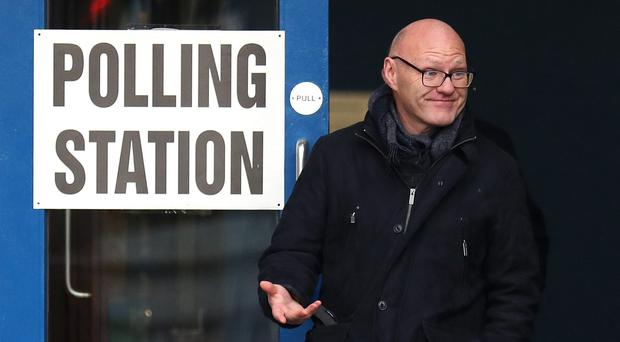 Sinn Fein's Paul Maskey leaves a polling station at St Teresa's in West Belfast as voting got under way in the general election. Photo by Peter Morrison