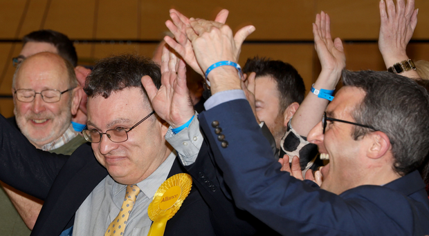 Stephen Farry and Alliance supporters celebrate winning seat in North Down