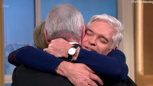 Video grab taken from ITV of TV presenter Phillip Schofield on ITV's This Morning being hugged by Eamonn Holmes after his announcement that he is gay. PA Photo. ITV/PA Wire