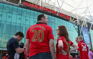 MANCHESTER, ENGLAND - AUGUST 26:  Manchester United fans look on prior to the Barclays Premier League match between Manchester United and Chelsea at Old Trafford on August 26, 2013 in Manchester, England.  (Photo by Alex Livesey/Getty Images)