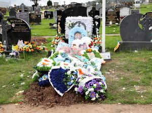 The grave of Warren Crossan in Milltown Cemetery before it was damaged. Photo Pacemaker Press