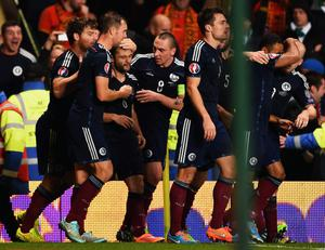 Pick it out: Shaun Maloney is mobbed after firing Scotland's winner against the Republic of Ireland at Celtic Park