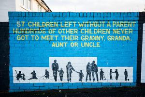 A mural on a wall in the Ballymurphy area of west Belfast where the shooting of 10 civilians took place in 1971. Credit: Liam McBurney/PA Wire