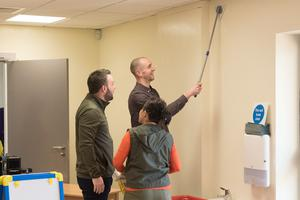 Colum Eastwood MP and Mark H Durkan MLA help with the cleanup in the North West Learning Disability Centre. Picture Martin McKeown. 01.03.20
