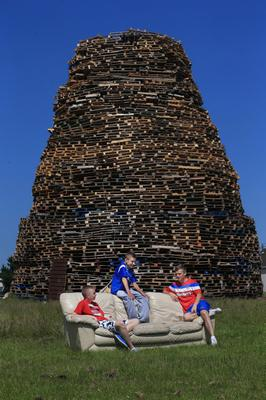 Presseye Northern Ireland - 10th July 2013 Mandatory Credit - Photo-William Cherry/Presseye  Youths tend the bonfire at the Ballymacash, Lisburn ahead of the Twelfth of July celebrations.