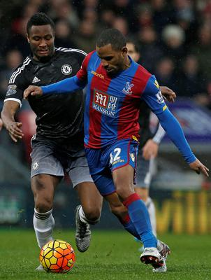 Chelsea's Nigerian midfielder John Obi Mikel (L) vies with Crystal Palace's English midfielder Jason Puncheon during the English Premier League football match between Crystal Palace and Chelsea at Selhurst Park in south London on January 3, 2016. AFP PHOTO / IKIMAGES  RESTRICTED TO EDITORIAL USE. NO USE WITH UNAUTHORIZED AUDIO, VIDEO, DATA, FIXTURE LISTS, CLUB/LEAGUE LOGOS OR 'LIVE' SERVICES. ONLINE IN-MATCH USE LIMITED TO 45 IMAGES, NO VIDEO EMULATION. NO USE IN BETTING, GAMES OR SINGLE CLUB/LEAGUE/PLAYER PUBLICATIONS.IKIMAGES/AFP/Getty Images