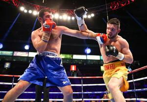 28th February 2015   ?William Cherry/Presseye  Conrad 'Dynamite' Cummings from Tyrone with Roberto Palenzuela of Spain during Saturdays Middleweight contest at the Odyssey arena, Belfast.