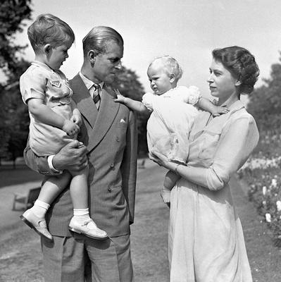 File photo dated 09/08/1951 of Princess Anne in the arms of Princess Elizabeth (now Queen Elizabeth II) with the Duke of Edinburgh, holding Prince Charles, in the grounds of Clarence House, their London residence as the Queen turns 90 on the April 21st. PRESS ASSOCIATION Photo. Issue date: Sunday April 3, 2016. See PA story ROYAL Birthday. Photo credit should read: PA Wire