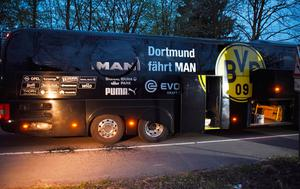 Borussia Dortmund's damaged bus is pictured after an explosion some 10km away from the stadium prior to the UEFA Champions League 1st leg quarter-final football match BVB Borussia Dortmund v Monaco in Dortmund, western Germany on April 11, 2017. / AFP PHOTO / Patrik STOLLARZPATRIK STOLLARZ/AFP/Getty Images