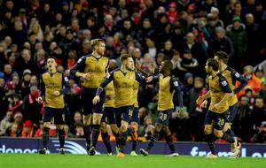"""Arsenal's Aaron Ramsey (centre) celebrates scoring his side's first goal of the game with teammates during the Barclays Premier League match at Anfield, Liverpool. PRESS ASSOCIATION Photo. Picture date: Wednesday January 13, 2016. See PA story SOCCER Liverpool. Photo credit should read: Richard Sellers/PA Wire. RESTRICTIONS: EDITORIAL USE ONLY No use with unauthorised audio, video, data, fixture lists, club/league logos or """"live"""" services. Online in-match use limited to 75 images, no video emulation. No use in betting, games or single club/league/player publications."""