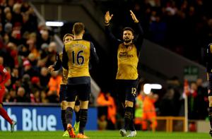 """Arsenal's Olivier Giroud (right) celebrates scoring his side's second goal of the game during the Barclays Premier League match at Anfield, Liverpool. PRESS ASSOCIATION Photo. Picture date: Wednesday January 13, 2016. See PA story SOCCER Liverpool. Photo credit should read: Richard Sellers/PA Wire. RESTRICTIONS: EDITORIAL USE ONLY No use with unauthorised audio, video, data, fixture lists, club/league logos or """"live"""" services. Online in-match use limited to 75 images, no video emulation. No use in betting, games or single club/league/player publications."""