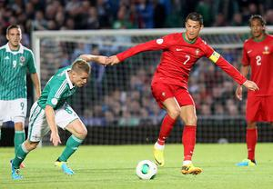 Northern Ireland's Steven Davis and Portugal's Cristiano Ronaldo during Friday's game in Belfast Photo David Maginnis/Pacemaker Press