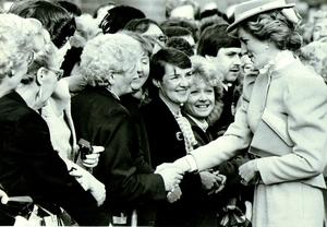 PRINCESS OF WALES: DIANA'S VISIT TO ULSTER 21/10/1985 / LOVELY TO SEE YOU, DIANATHE PRINCESS OF WALES SHAKES HANDS WITH WELL- WISHERS OUTSIDE THE UNIVERSITY OF ULSTER, AT YORK STREET,BELFAST, TODAY.......