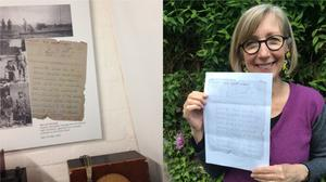 A picture of Dr Jennifer Iles' father's note recording the German surrender at the end of the Second World War while Dr Iles stands with a photocopy on the right (Jennifer Iles/PA)