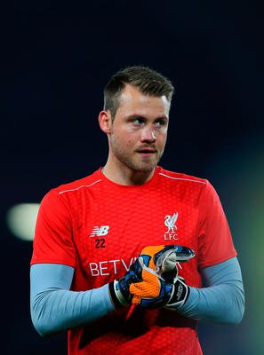 Simon Mignolet of Liverpool warms up prior to kick off during the EFL Cup fourth round match between Liverpool and Tottenham Hotspur at Anfield on October 25, 2016 in Liverpool, England.  (Photo by Jan Kruger/Getty Images)