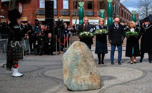 Wendy Parry (fourth right) and her husband Colin (third right) lay flowers at the memorial stone on Bridge Street, in Warrington, where two IRA bombs were detonated, killing their son Tim Parry, 12, and Johnathan Ball, three, and injuring over fifty others, during the 25th anniversary service of the Warrington bombing attack. PRESS ASSOCIATION Photo. Picture date: Tuesday March 20, 2018. See PA story MEMORIAL Warrington. Photo credit should read: Peter Byrne/PA Wire