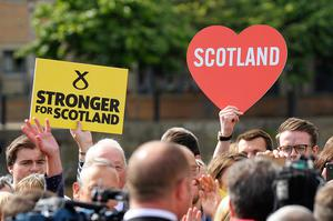 Supporters hold placards as they attend the final general election campaign rally of Scotland's First Minister and leader of the Scottish National Party Nicola Sturgeon on June 7, 2017, in Edinburgh, Scotland. Britain on June 3 headed into the final day of campaigning for a general election darkened and dominated by jihadist attacks in two cities, leaving forecasters struggling to predict an outcome on polling day.   / AFP PHOTO / Andy BuchananANDY BUCHANAN/AFP/Getty Images