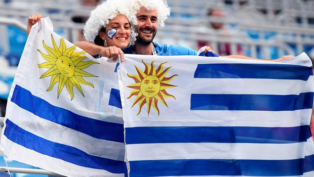 Uruguay's fans pose with national flags before the Russia 2018 World Cup quarter-final football match between Uruguay and France at the Nizhny Novgorod Stadium in Nizhny Novgorod on July 6, 2018. / AFP PHOTO / Kirill KUDRYAVTSEVKIRILL KUDRYAVTSEV/AFP/Getty Images