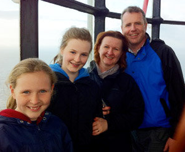 Bernie and her husband Kevin McClelland and daughters Mary and Rosie, taken at the top of the East Lighthouse on Rathlin
