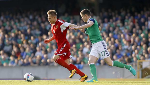 Picture - Kevin Scott / Presseye  Belfast , UK - May 27, Pictured is Northern Irelands Paddy McNair and Belarus' Siarhei Krivets in action during the last home game before heading to the Euros on May 27 2016 in Belfast , Northern Ireland ( Photo by Kevin Scott / Presseye)