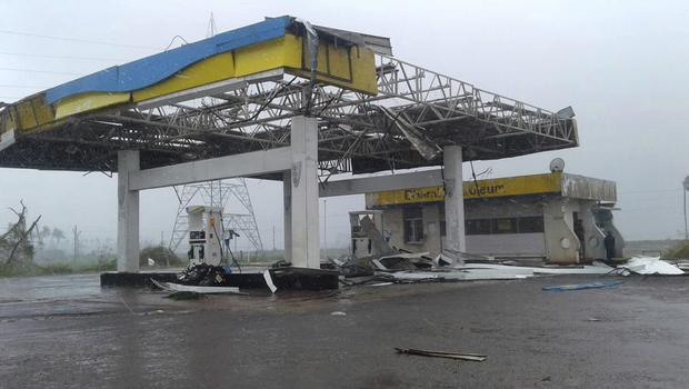 A petrol station is pulled apart by the storm near Puri (AP)