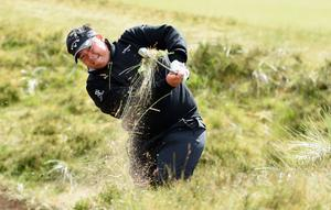 NEWCASTLE, NORTHERN IRELAND - MAY 28:  Kiradech Aphibarnrat of Thailand hits his 2nd shot on the 13th hole during the First Round of the Dubai Duty Free Irish Open Hosted by the Rory Foundation at Royal County Down Golf Club on May 28, 2015 in Newcastle, Northern Ireland.  (Photo by Ross Kinnaird/Getty Images)