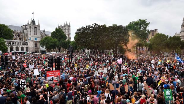 Thousands of demonstrators gather to hear speeches in Parliament Square during a protest against the British government's spending cuts and austerity measures in London on June 20, 2015. The national demonstration against austerity was organised by People's Assembly against government spending cuts.   AFP PHOTO / BEN STANSALLBEN STANSALL/AFP/Getty Images